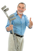Senior man with crutches — Stock Photo
