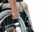 Hand of senior woman on wheelchair — Stock Photo