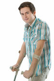 Young man on crutches — Stock Photo