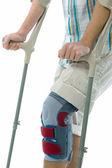 Man on crutches — Stock Photo