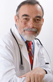 Closeup portrait of a happy senior doctor — Stock Photo