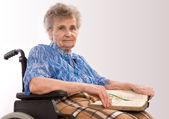 Portrait of an elderly woman in wheelchair — Stock Photo