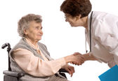 Health care worker helps elderly woman — Stock Photo