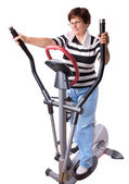 Senior woman exercise on spinning bicycle — Stock Photo