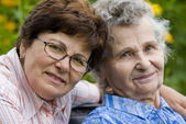 Senior woman with her home caregiver — Stock Photo