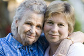 Elderly woman with her daughter — Stock Photo