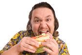 Muž jí sendvič — Stock fotografie