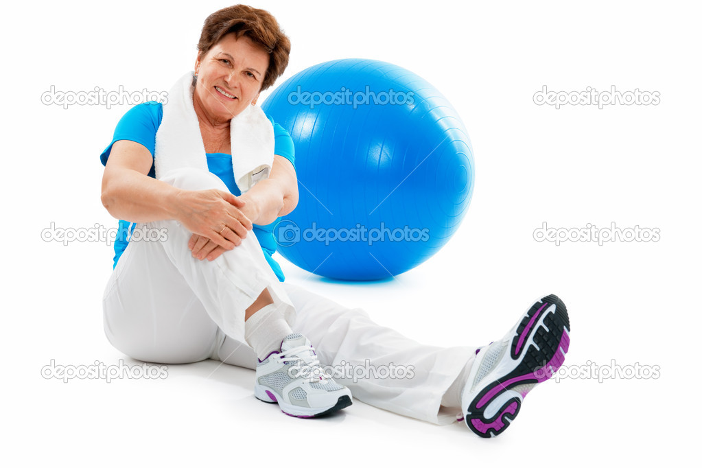 Senior Woman Resting After Exercises In Gym  — Stock Photo #6860555
