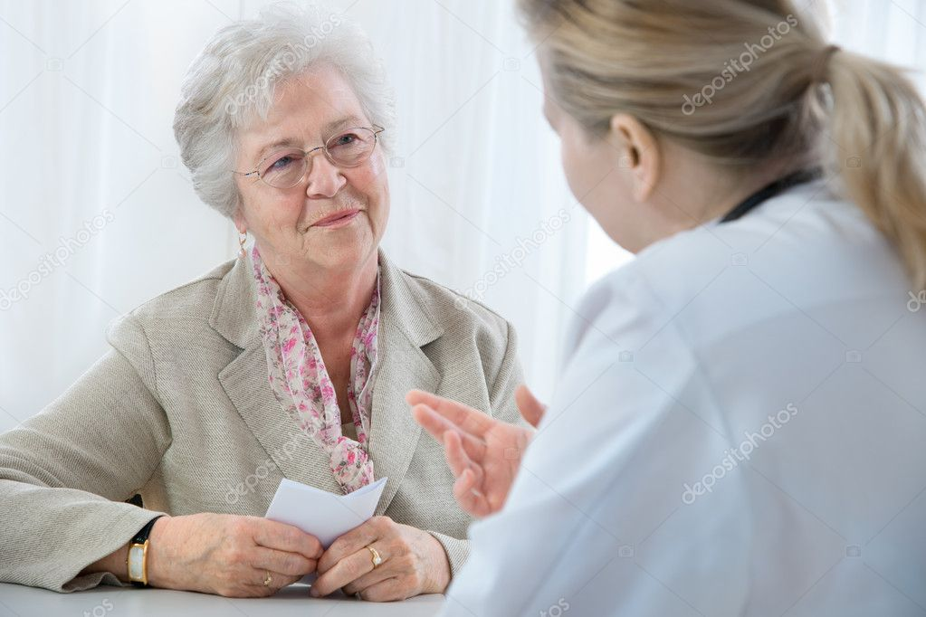 Doctor explaining diagnosis to his female patient   Stock Photo #6868611