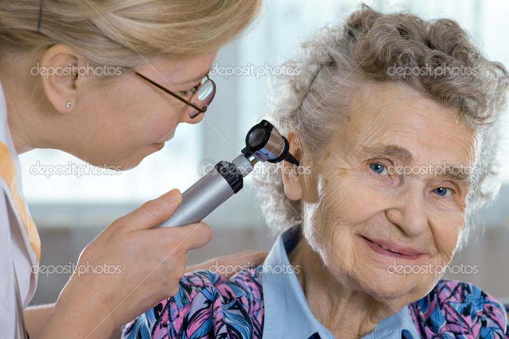 Doctor performing ear exam with otoscope on a senior patient  — Stock Photo #6868657