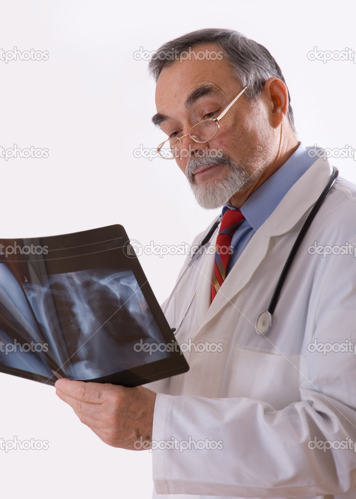 Doctor looking at an xray  — Stock Photo #6868779