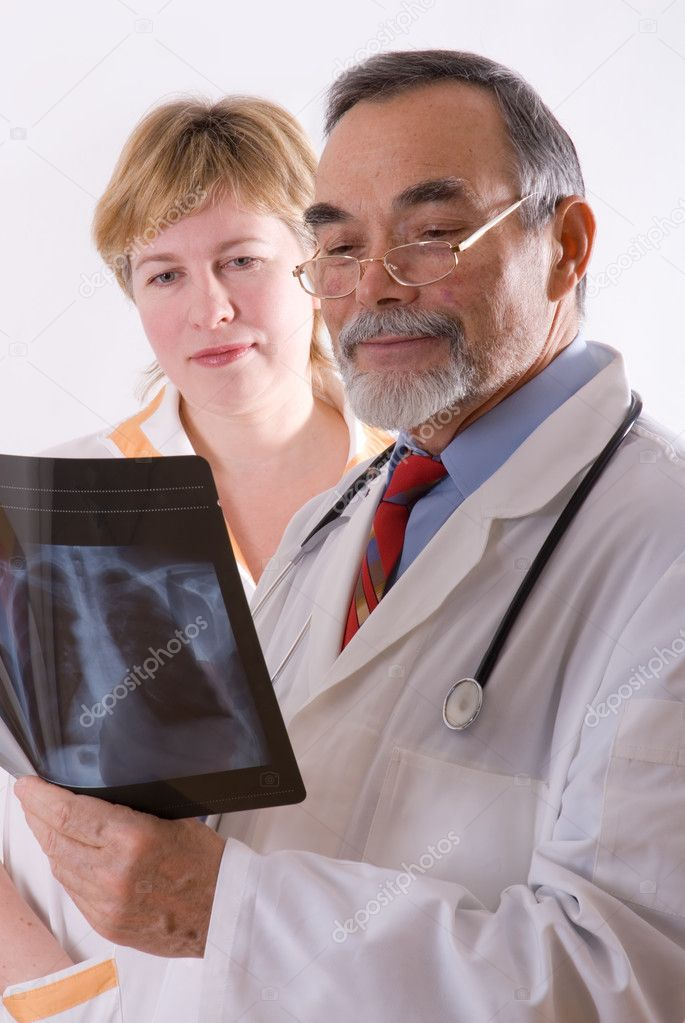 Two doctors looking at an xray  — Stock Photo #6868786