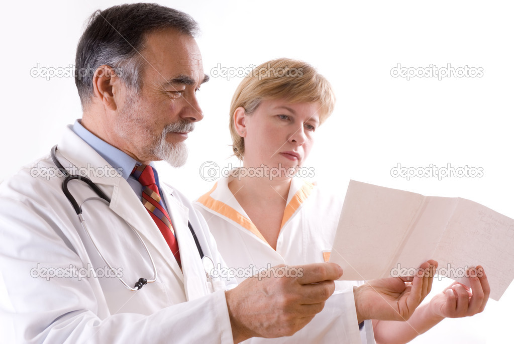 Two doctors looking at an EKG  — Stock Photo #6868794