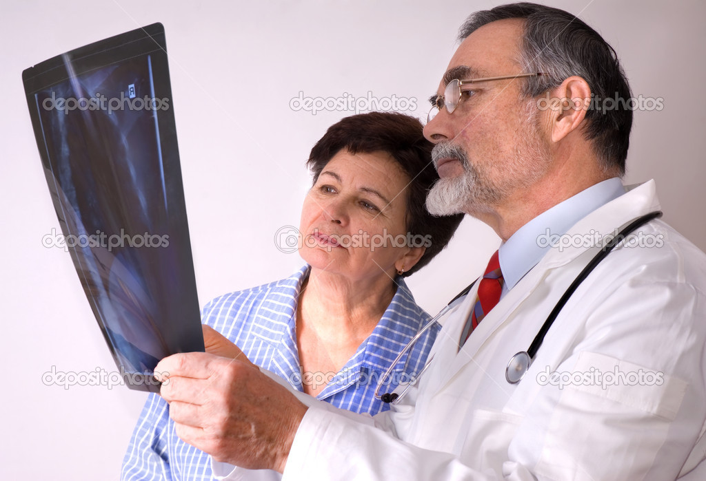 Doctor explaining x-ray results to patient   Stock Photo #6868862