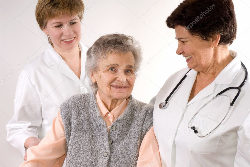 Health care workers and elderly woman needs help  — Stock Photo #6868877