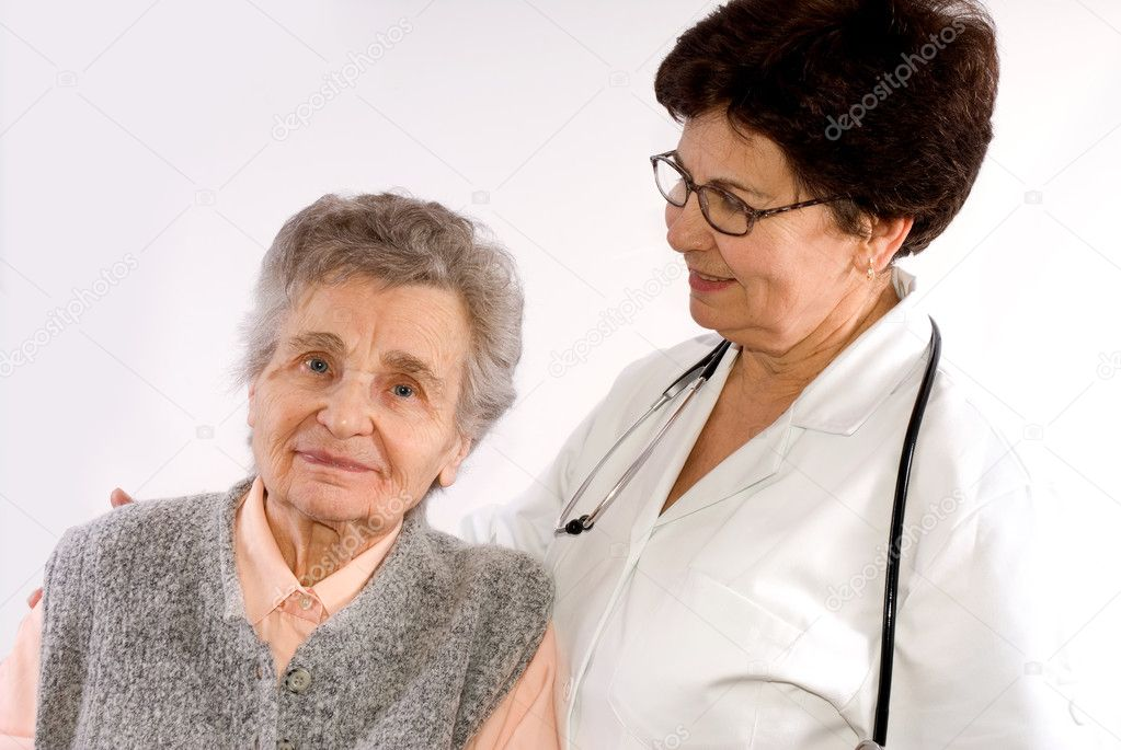Health care worker helps  elderly woman   Stock Photo #6868885