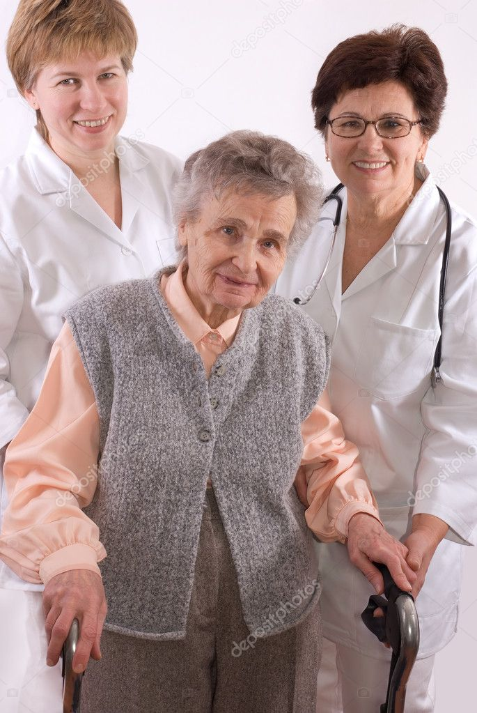 Health care workers and elderly woman needs help  — Stock Photo #6868895