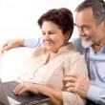 Senior couple using laptop — Stock Photo