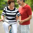 Senior couple cycling — Stock Photo #6870295