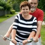 Senior couple cycling — Stock Photo