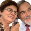 Couple receiving good news over the phone — Stock Photo