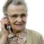 Senior woman using telephone — Stock Photo