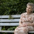 Woman on the park bench — Stock Photo