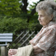 Woman on the park bench — Stock Photo #6870450