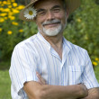 Portrait of senior man gardening - Stockfoto