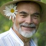 Senior with ox-eye daisy — Stock Photo #6870559