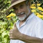 Senior showing thumb up — Stock Photo #6870569