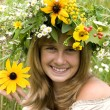 Girl with flower wreath in the meadow — Stock Photo
