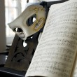 Grand Piano, lyrics book and venice mask - Stock Photo