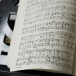 Grand Piano and lyrics book, focus on notes - Stock Photo