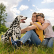 Loving couple with a Dalmatian outdoors — Stock Photo #6872888