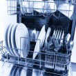 Cleaned dishes in dishwasher - Stock Photo
