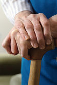 Hands on a cane — Stock Photo
