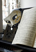Grand Piano, lyrics book and venice mask — Stock Photo