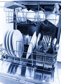 Cleaned dishes in dishwasher — Stock Photo