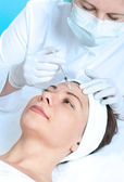 Botox injection — Stockfoto