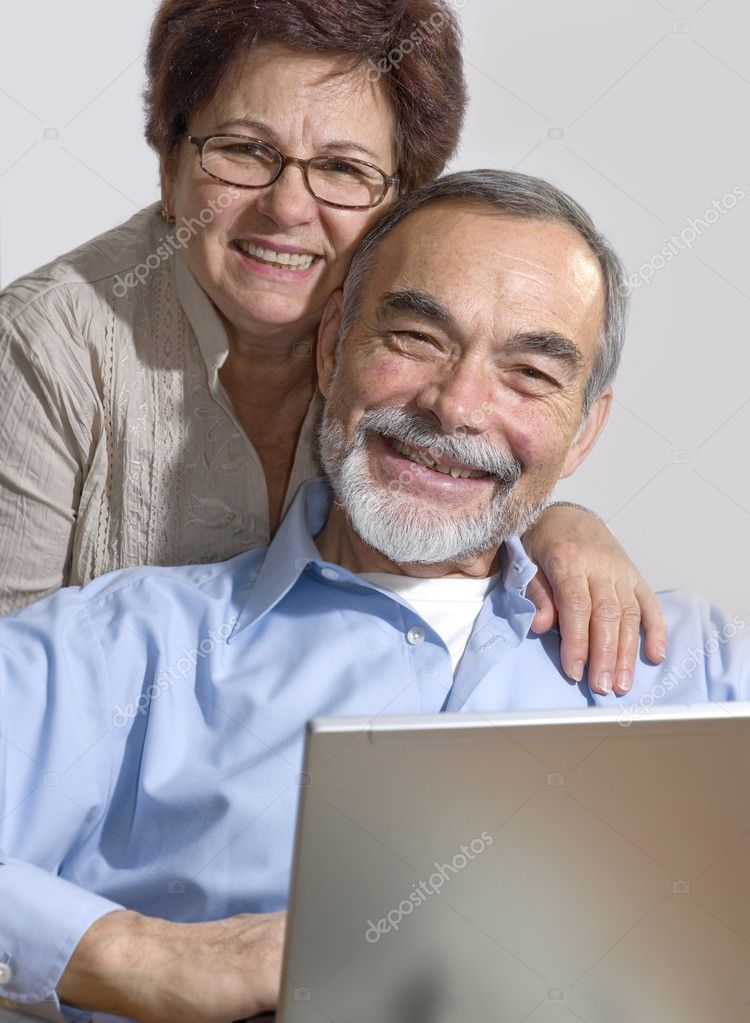 Senior couple using laptop at home. Concept may be is shopping in internet   — Stock Photo #6870077