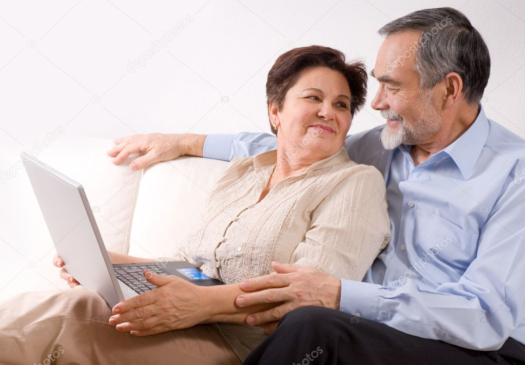 Senior couple using laptop at home. Concept may be is shopping in internet   — Stock Photo #6870246