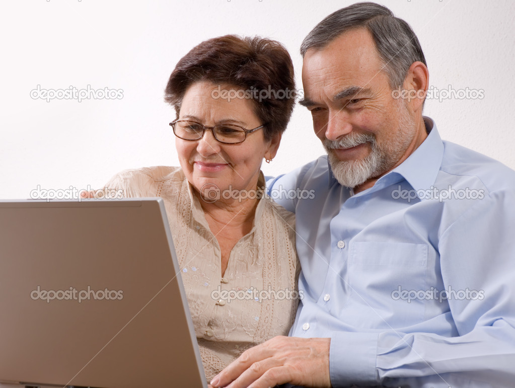 Senior couple using laptop at home. Concept may be is shopping in internet    Stock Photo #6870260