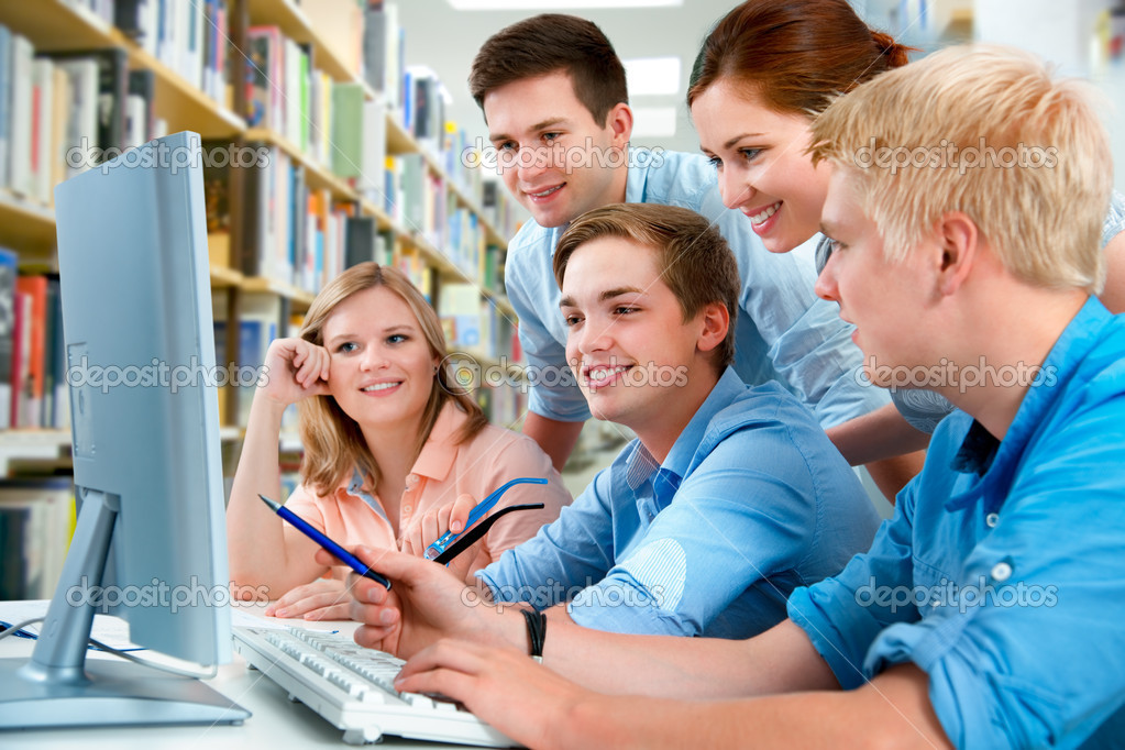 Group of students studying together in a library — Stock Photo #6873966