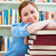 Student in a college library — Stock Photo