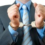 Постер, плакат: Businessman in handcuffs