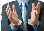 Businessman in handcuffs — Stock Photo