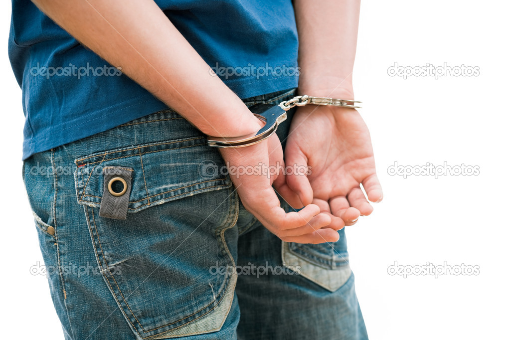 Young man in handcuffs — Stock Photo #7149086