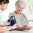 Measuring blood pressure - Stock Photo