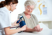 Measuring blood pressure — Foto Stock